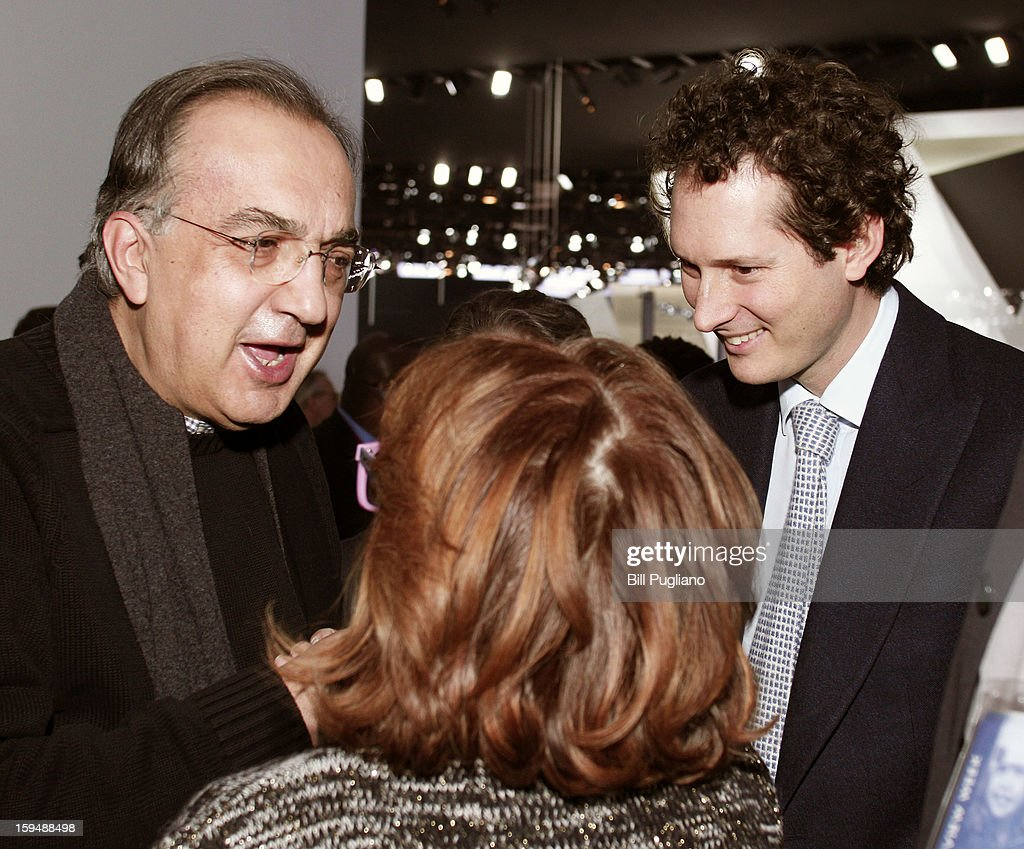 Chrysler Group Chairman and CEO Sergio Marchionne (left) and Fiat Chairman John Elkann (right) speak with a woman before attending the introduction of the new Jeep Grand Cherokee at the media preview of the 2013 North American International Auto Show at the Cobo Center January 14, 2013 in Detroit, Michigan. Approximately 6,000 members of the media from 68 countries are attending the show this year. The 2013 NAIAS opens to the public January 19th.