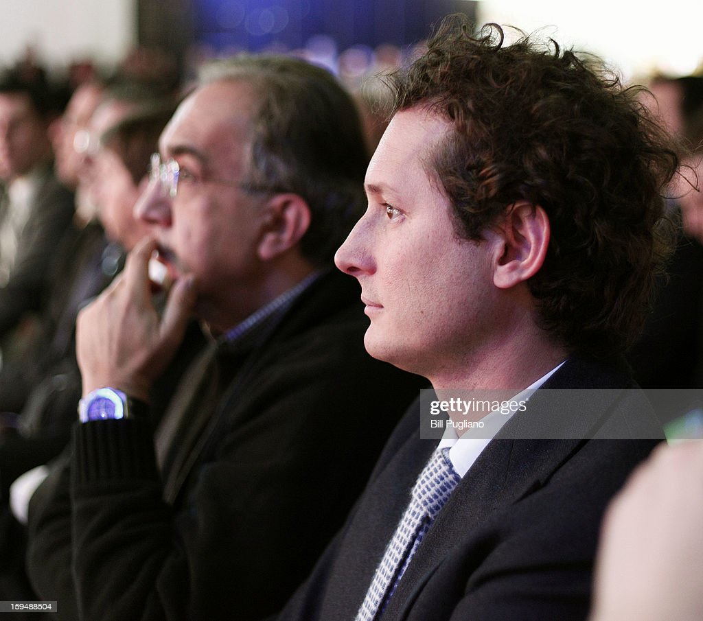 Chrysler Group Chairman and CEO Sergio Marchionne (left) and Fiat Chairman John Elkann (right) watch the introduction of the new Jeep Grand Cherokee at the media preview of the 2013 North American International Auto Show at the Cobo Center January 14, 2013 in Detroit, Michigan. Approximately 6,000 members of the media from 68 countries are attending the show this year. The 2013 NAIAS opens to the public January 19th.