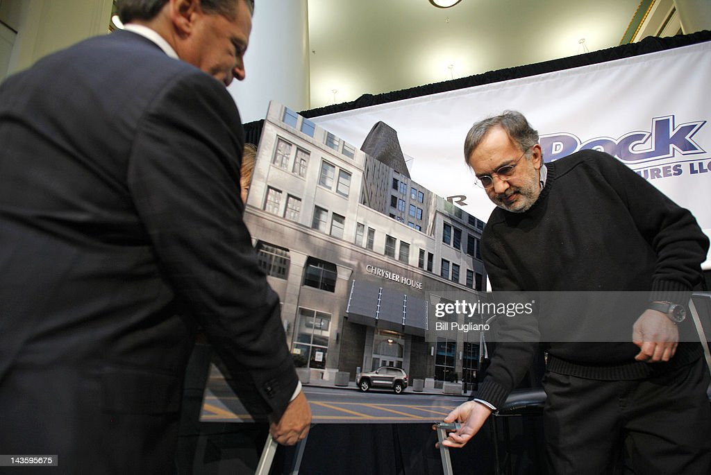 Chrysler Group Chairman and CEO Sergio Marchionne (R) and Rock Ventures and Quicken Loans Chairman Dan Gilbert (L) move a photo mockup after they announced that Chrysler will have an office presence in downtown Detroit for the first time April 30, 2012 in Detroit, Michigan. The Chrysler Group will be renaming the Rock Ventures Historic Dime Building (pictured in mockup) the 'Chrysler House'.