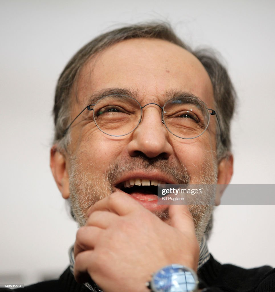Chrysler Group Chairman and CEO <a gi-track='captionPersonalityLinkClicked' href=/galleries/search?phrase=Sergio+Marchionne&family=editorial&specificpeople=608333 ng-click='$event.stopPropagation()'>Sergio Marchionne</a> answers questions from the media after he and and Rock Ventures and Quicken Loans Chairman Dan Gilbert announced that Chrysler will have an office presence in downtown Detroit for the first time April 30, 2012 in Detroit, Michigan. The Chrysler Group will be renaming the Rock Ventures Historic Dime Building (pictured in mockup) the 'Chrysler House'.