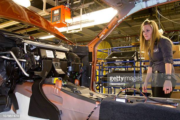 A Chrysler Group LLC employee inspects a vehicle on the production line at Chrysler's assembly plant in Brampton Ontario Canada on Friday Jan 7 2011...