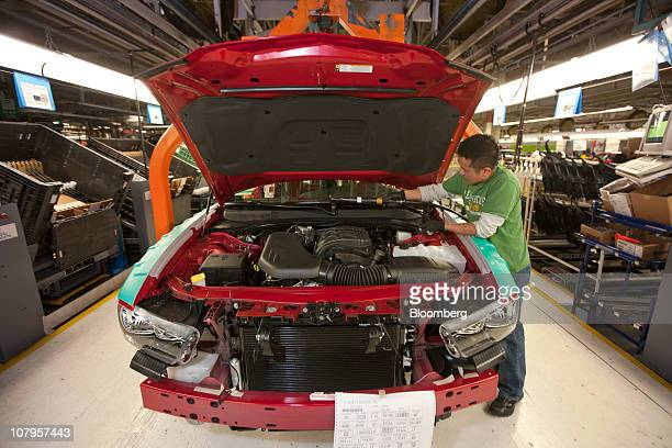 A Chrysler Group LLC employee works on the production line at Chrysler's assembly plant in Brampton Ontario Canada on Friday Jan 7 2011 Chrysler...