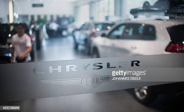 A Chrysler logo is pictured at a car dealership in Shanghai on August 6 2014 German luxury car maker Audi and Chrysler of the United States have...