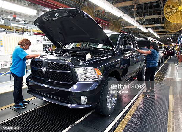 Chrysler Ram 1500 truck goes through a quality control inspection before rolling off the assembly line at the Warren Truck Assembly Plant September...