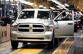 Chrysler Ram 1500 trucks come off the assembly line at the Warren Truck Assembly Plant September 25 2014 in Warren Michigan The plant redesigned its...