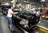 Chrysler workers install a windshield into A Chrysler Ram 1500 truck as it goes through the assembly line at the Warren Truck Assembly Plant...