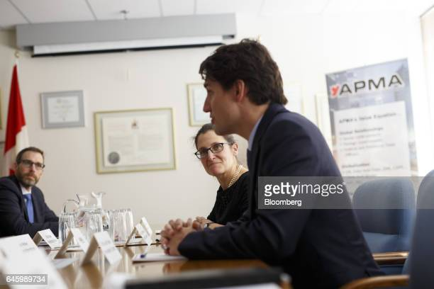 Chrystia Freeland Canada's foreign affairs minister listens as Justin Trudeau Canada's prime minister right speaks during a roundtable discussion...