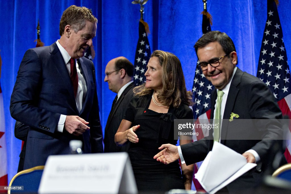 Chrystia Freeland, Canada's minister of foreign affairs, center, talks to Bob Lighthizer, U.S. trade representative, next to Ildefonso Guajardo Villarreal, secretary of economy for Mexico, right, after opening statements during the first round of North American Free Trade Agreement (NAFTA) renegotiations in Washington, D.C., U.S., on Wednesday, Aug. 16, 2017. Canada and Mexico largely want to defend the advantages they have enjoyed under the two-decade-old Nafta deal, keep it free of tariffs and broaden it to new industries. President Donald Trump has called Nafta the worst trade pact in history and promised to fix it through negotiations or withdraw. Photographer: Andrew Harrer/Bloomberg via Getty Images