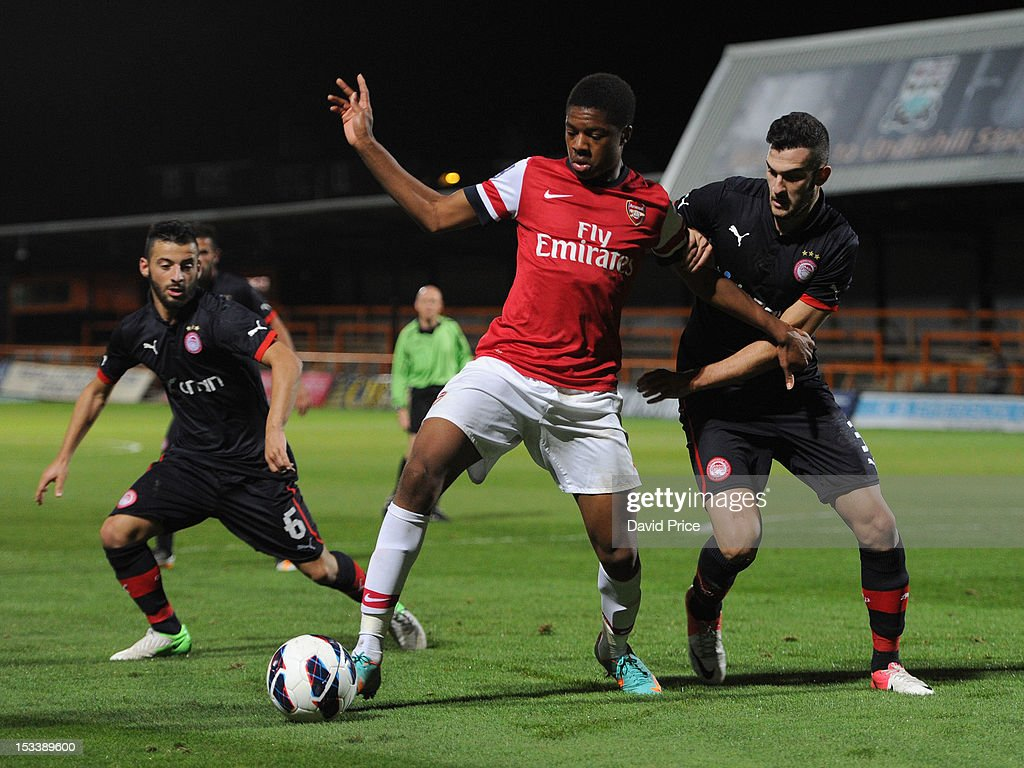 Chub Akpom of Arsenal shields the ball from Charalampos Lykogiannis as Emmenouil Siopos of Olympiacos closes in during the NextGen Series match between Arsenal U19 and Olympiacos U19 at Underhill Stadium on October 4, 2012 in Barnet, United Kingdom.