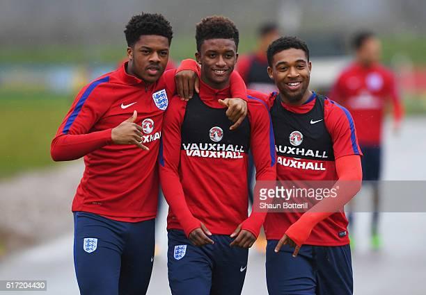 Chuba Akpom Demarai Gray and Jordon Ibe joke during an England U21 training session ahead of their UEFA U21 European Championship qualifier against...