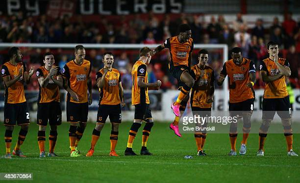 Chuba Akpom leaps above his team mates to celebrate in the penalty shoot out during the Capital One Cup First Round match between Accrington Stanley...