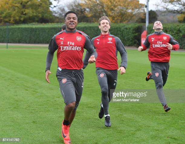 Chuba Akpom Nacho Monreal and Sead Kolasinac of Arsenal during a training session at London Colney on November 14 2017 in St Albans England