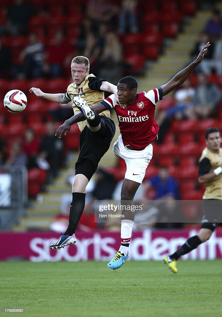 <a gi-track='captionPersonalityLinkClicked' href=/galleries/search?phrase=Chuba+Akpom&family=editorial&specificpeople=8082058 ng-click='$event.stopPropagation()'>Chuba Akpom</a> of Arsenal battles in the air with Nathan Clarke of Leyton Orient during a pre season friendly match between Leyton Orient and an Arsenal XI at the Matchroom Stadium on July 30, 2013 in London, England.