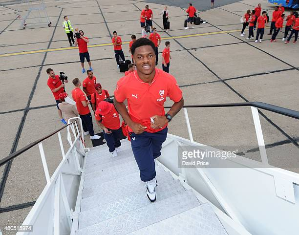 Chuba Akpom of Arsenal boards the Emirates plane at Stansted Airport on July 12 2015 in London England