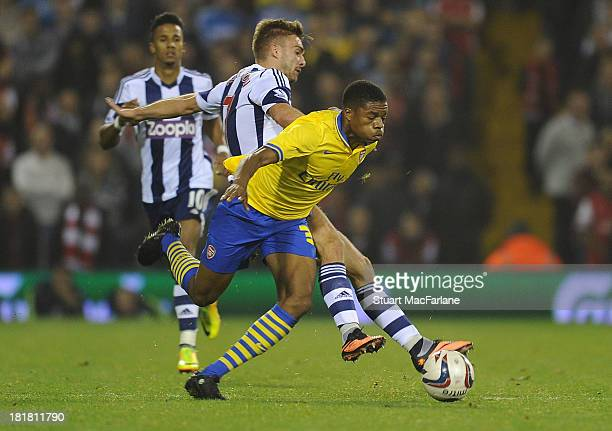 Chuba Akpom of Arsenal breaks past James Morrison of West Brom during the 3rd round Capital One Cup match between West Bromwich Albion and Arsenal at...
