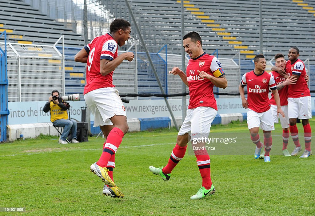 <a gi-track='captionPersonalityLinkClicked' href=/galleries/search?phrase=Chuba+Akpom&family=editorial&specificpeople=8082058 ng-click='$event.stopPropagation()'>Chuba Akpom</a> of Arsenal celebrates scoring the 1st Arsenal goal with Nico Yennaris during the NextGen Series Semi Final match between Arsenal and Chelsea at Stadio Guiseppe Sinigallia on March 29, 2013 in Como, Italy.