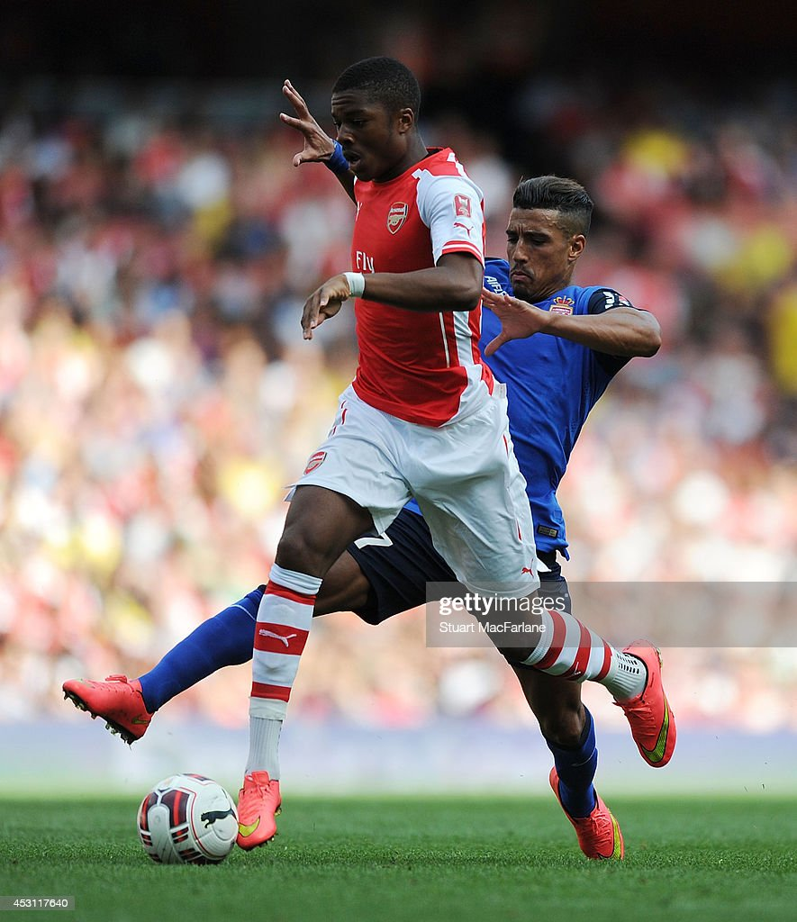 Chuba Akpom of Arsenal challenged by Nabil Dirar of AS Monaco during the Emirates Cup match between Arsenal and AS Monaco at Emirates Stadium on August 3, 2014 in London, England.