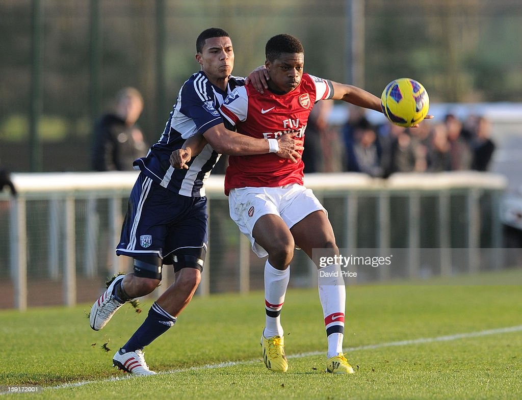 Chuba Akpom of Arsenal holds off Bradley Garmston of WBA during the Barclays Premier U21 match between Arsenal U21 and West Bromwich Albion U21 at London Colney on January 9, 2013 in St Albans, United Kingdom.