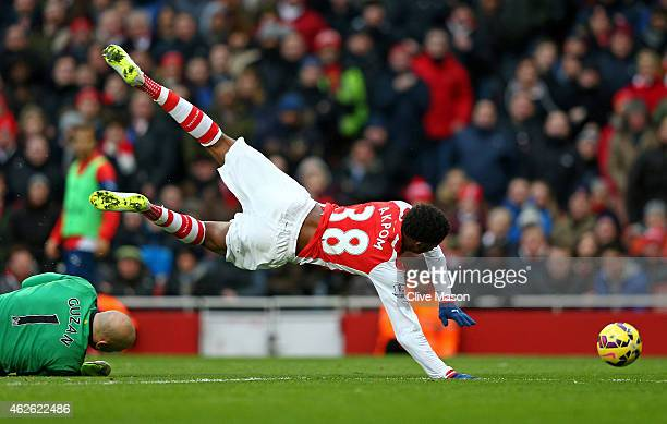 Chuba Akpom of Arsenal is brought down by goalkeeper Brad Guzan of Aston Villa to concede a penalty during the Barclays Premier League match between...
