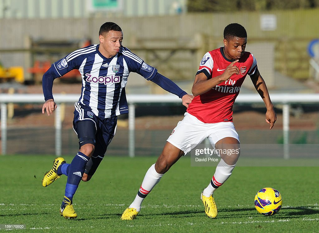 <a gi-track='captionPersonalityLinkClicked' href=/galleries/search?phrase=Chuba+Akpom&family=editorial&specificpeople=8082058 ng-click='$event.stopPropagation()'>Chuba Akpom</a> of Arsenal races away from Wesley Atkinson of WBA during the Barclays Premier U21 match between Arsenal U21 and West Bromwich Albion U21 at London Colney on January 9, 2013 in St Albans, United Kingdom.