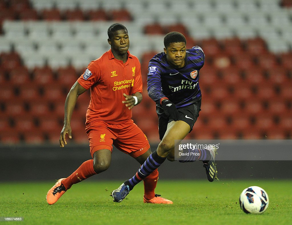 <a gi-track='captionPersonalityLinkClicked' href=/galleries/search?phrase=Chuba+Akpom&family=editorial&specificpeople=8082058 ng-click='$event.stopPropagation()'>Chuba Akpom</a> of Arsenal takes on Stephen Sama of Liverpool during the Barclays Under-21 League match between Liverpool U21 and Arsenal U21 at Anfield on April 08, 2013 in Liverpool, England.