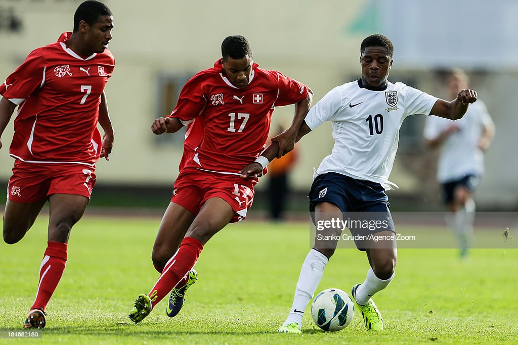 Chuba Akpom of England and Miguel Castroman of Switzerland in action during the UEFA U19 Championships Qualifier between England and Switzerland, on October 15, 2013 in Ptuj, Slovenia.