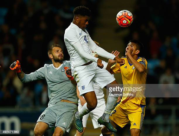 Chuba Akpom of England heads toward goal under pressure from Stanislav Pavlov of Kazakhstan during the European Under 21 Qualifier between England...