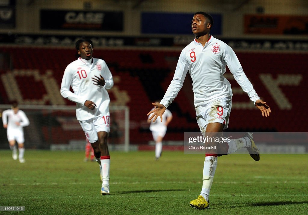 <a gi-track='captionPersonalityLinkClicked' href=/galleries/search?phrase=Chuba+Akpom&family=editorial&specificpeople=8082058 ng-click='$event.stopPropagation()'>Chuba Akpom</a> (R) of England U19 celebrates scoring the opening goal during the International Match between England U19 and Denmark U19 at Keepmoat Stadium on February 5, 2013 in Doncaster, England.