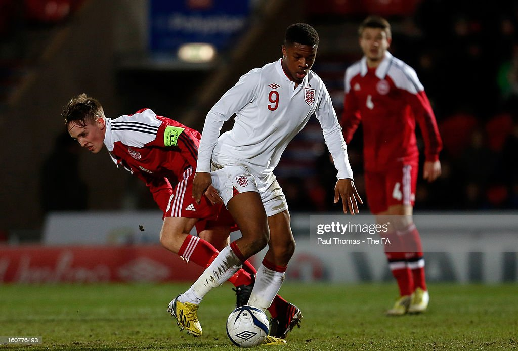 <a gi-track='captionPersonalityLinkClicked' href=/galleries/search?phrase=Chuba+Akpom&family=editorial&specificpeople=8082058 ng-click='$event.stopPropagation()'>Chuba Akpom</a> (C) of England U19 in action with Lasse Vigen Christensen of Denmark U19 during the International U19 match between England and Scotland at the Keepmoat Stadium on February 5, 2013 in Doncaster, England.