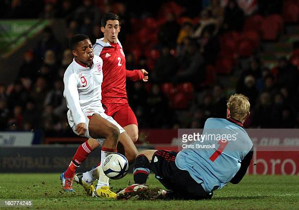 Chuba Akpom of England U19 scores his side's second goal past Oliver Korch of Denmark U19 during the International Match between England U19 and...