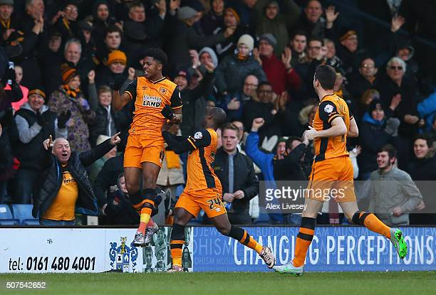 Chuba Akpom of Hull City celebrates scoring his team's first goal with his team mate Sone Aluko during The Emirates FA Cup fourth round match at...