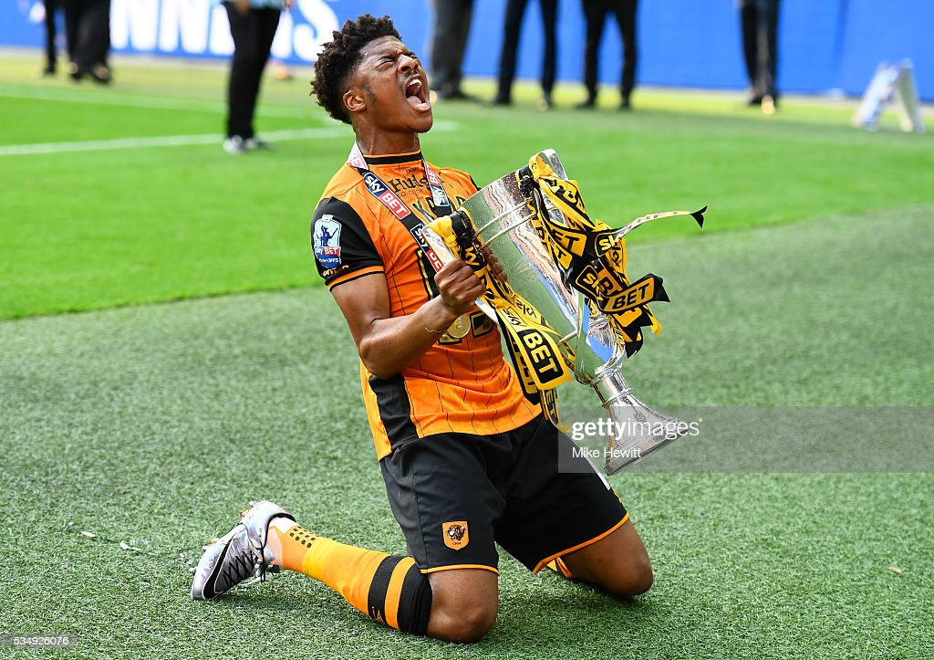 <a gi-track='captionPersonalityLinkClicked' href=/galleries/search?phrase=Chuba+Akpom&family=editorial&specificpeople=8082058 ng-click='$event.stopPropagation()'>Chuba Akpom</a> of Hull City celebrates with the trophy after the Sky Bet Championship Play Off Final match between Hull City and Sheffield Wednesday at Wembley Stadium on May 28, 2016 in London, England.