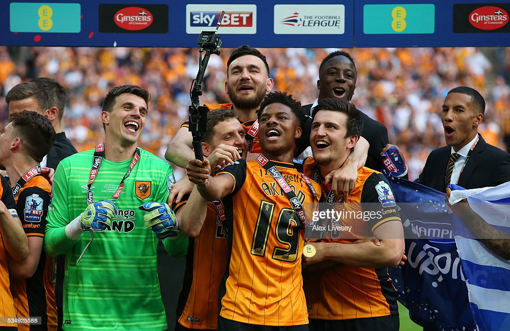 <a gi-track='captionPersonalityLinkClicked' href=/galleries/search?phrase=Chuba+Akpom&family=editorial&specificpeople=8082058 ng-click='$event.stopPropagation()'>Chuba Akpom</a> of Hull City takes a selfie as he celebrates with teammates after the Sky Bet Championship Play Off Final match between Hull City and Sheffield Wednesday at Wembley Stadium on May 28, 2016 in London, England.