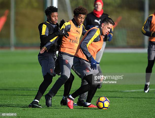 Chuba Akpom Reiss Nelson and Gabriel of Arsenal during a training session at London Colney on January 13 2017 in St Albans England