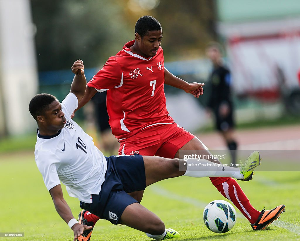 Chuba Akpon of England and Saidy Janko in action during the UEFA U19 Championships Qualifier between England and Switzerland, on October 15, 2013 in Ptuj, Slovenia.