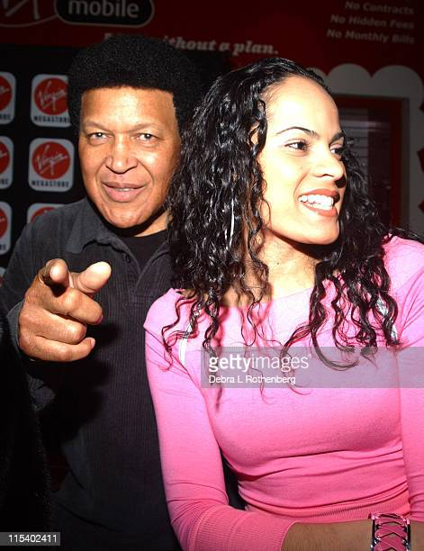 Chubby Checker and Vivienne during Chubby Checker Signs Copies Of 'Limbo Rock Remixes' at Times Square Virgin Megastore in New York City New York...