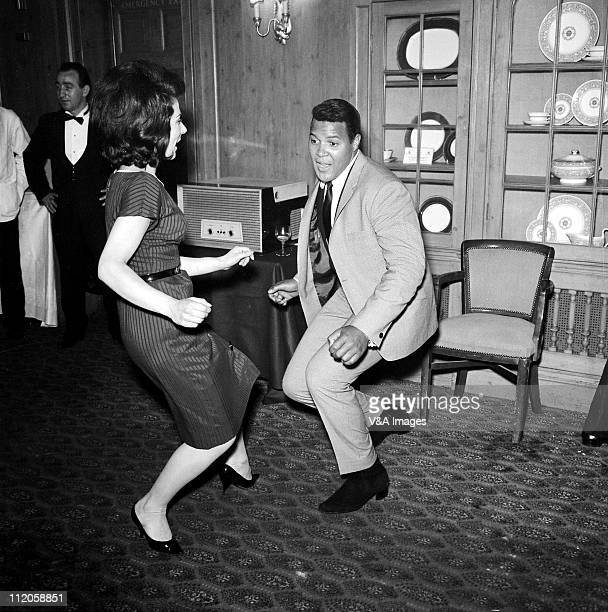 Chubby Checker dancing doing the twist at press reception 1960