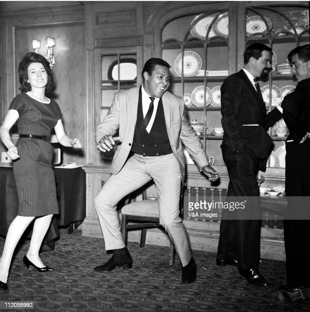 Chubby Checker doing the twist at press reception 1960