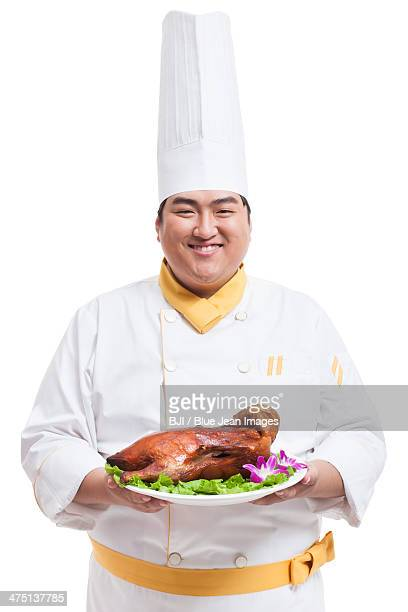Chubby cook with roast duck