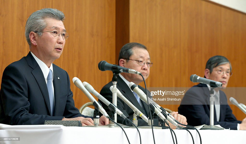 Chubu Electric Power Co Incoming President Satoru Katsuno speaks while chairman Toshio Mita and outgoing president Akihisa Mizuno listen during a...