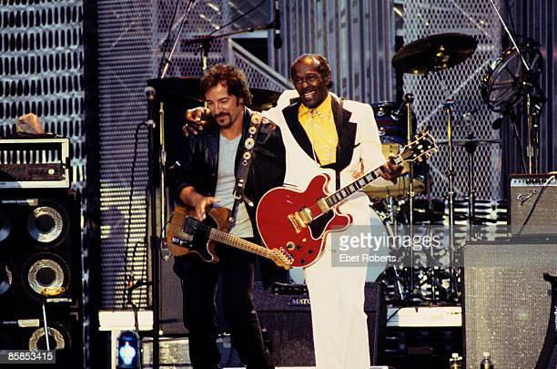 Photo of Chuck BERRY and Bruce SPRINGSTEEN Chuck Berry and Bruce Springsteen performing on stage at the Rock and Roll Hall of Fame Concert