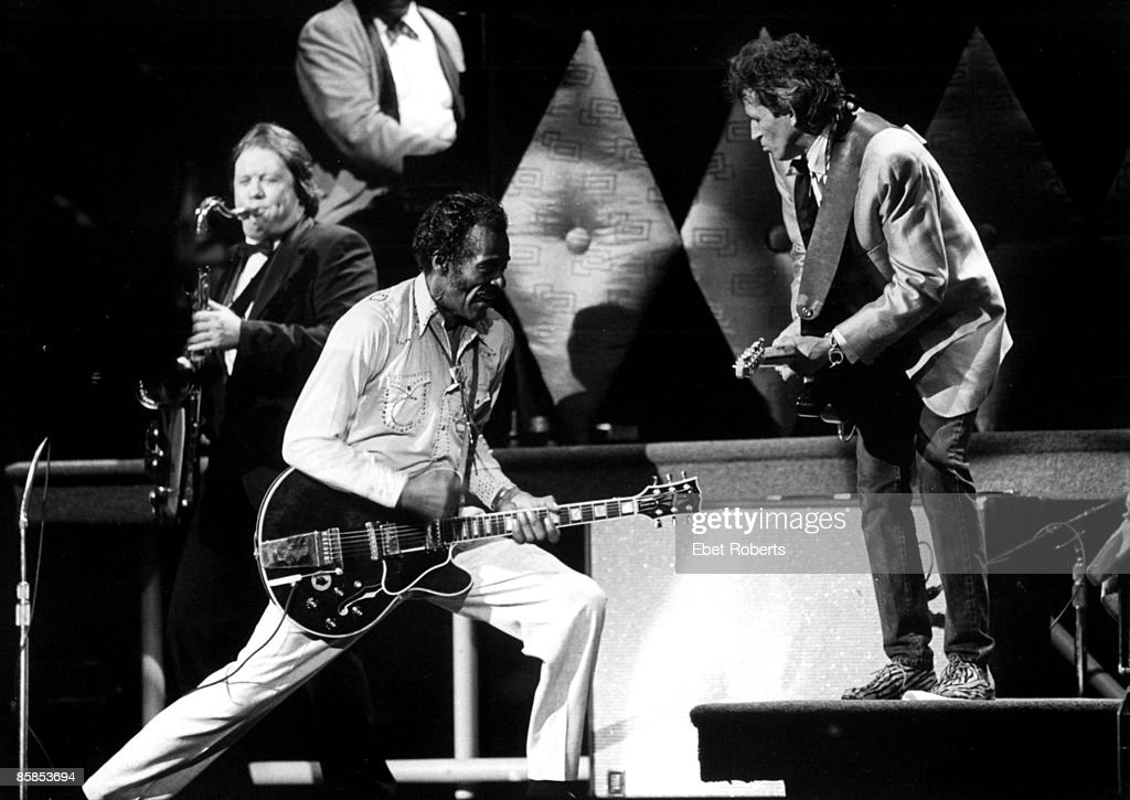 Photo of Chuck BERRY and Keith RICHARDS and Bobby KEYS; <a gi-track='captionPersonalityLinkClicked' href=/galleries/search?phrase=Bobby+Keys&family=editorial&specificpeople=4031609 ng-click='$event.stopPropagation()'>Bobby Keys</a>, Chuck Berry and <a gi-track='captionPersonalityLinkClicked' href=/galleries/search?phrase=Keith+Richards+-+Musician&family=editorial&specificpeople=202882 ng-click='$event.stopPropagation()'>Keith Richards</a> performing on stage at Chuck's 60th Birthday Concert for the filming of 'Hail Hail Rock & Roll'
