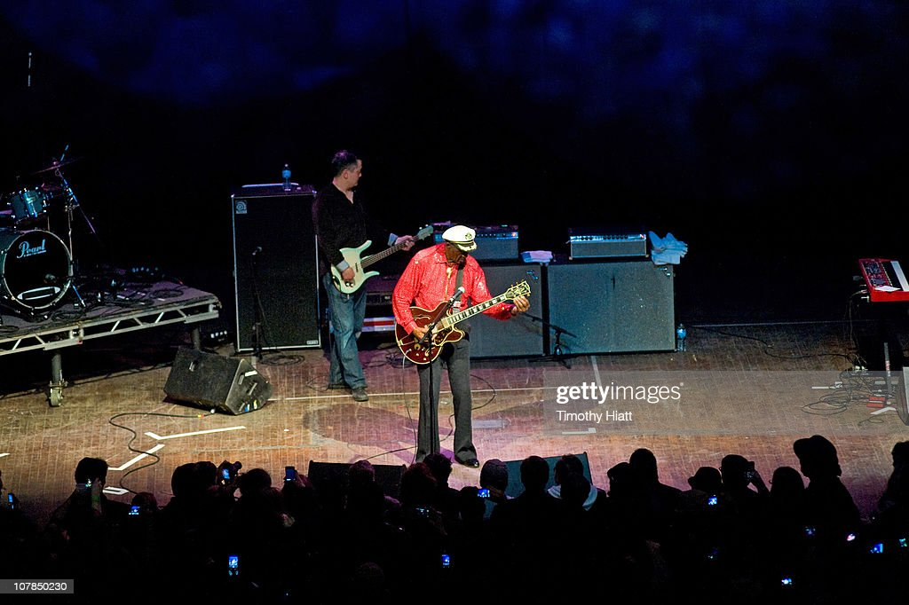 Chuck Berry returns to the stage after collapsing at the Congress Theater on January 1, 2011 in Chicago, Illinois.