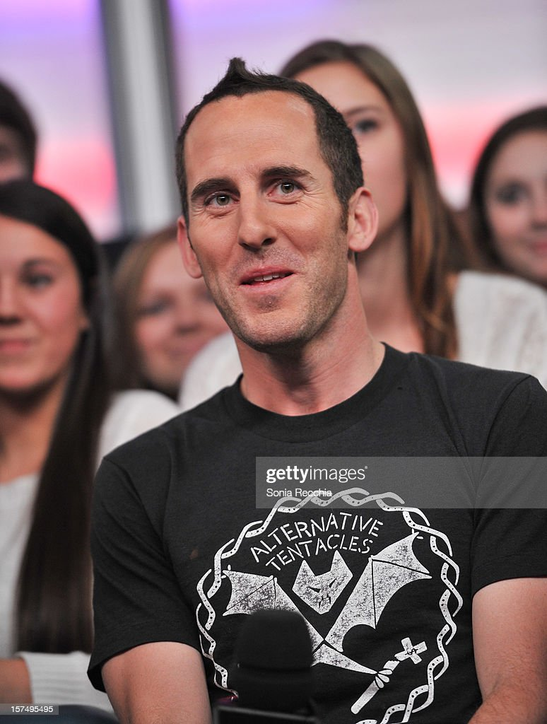 <a gi-track='captionPersonalityLinkClicked' href=/galleries/search?phrase=Chuck+Comeau&family=editorial&specificpeople=215359 ng-click='$event.stopPropagation()'>Chuck Comeau</a> attends Simple Plan On New.Music.Live attends at MuchMusic Headquarters on December 3, 2012 in Toronto, Canada.