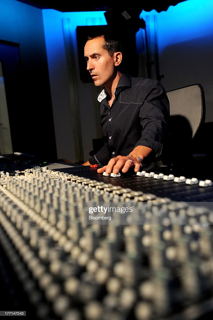 Chuck Doud, director of music, works at a mixing console at Sony Computer Entertainment America's headquarters in San Mateo, California, U.S., on Tuesday, Aug. 20, 2013. Sony Corp. will start selling the PlayStation 4 in North America on Nov. 15, moving to obtain an early advantage in the largest video-game market against Microsoft Corp. Photographer: Noah Berger/Bloomberg via Getty Images