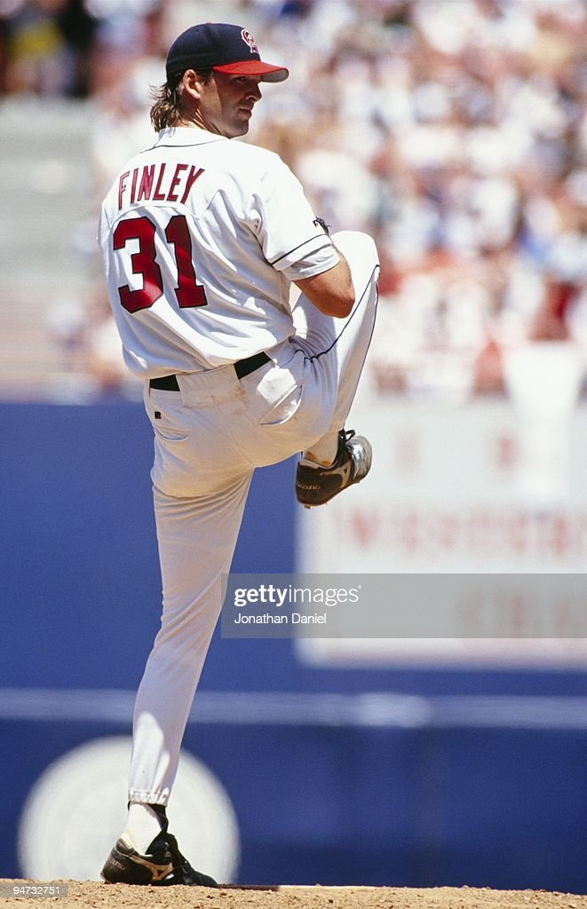<a gi-track='captionPersonalityLinkClicked' href=/galleries/search?phrase=Chuck+Finley&family=editorial&specificpeople=242777 ng-click='$event.stopPropagation()'>Chuck Finley</a> #31 of the California Angels pitches against the New York Yankees during their game at Anaheim Stadium on July 11, 1993 in Anaheim, California.