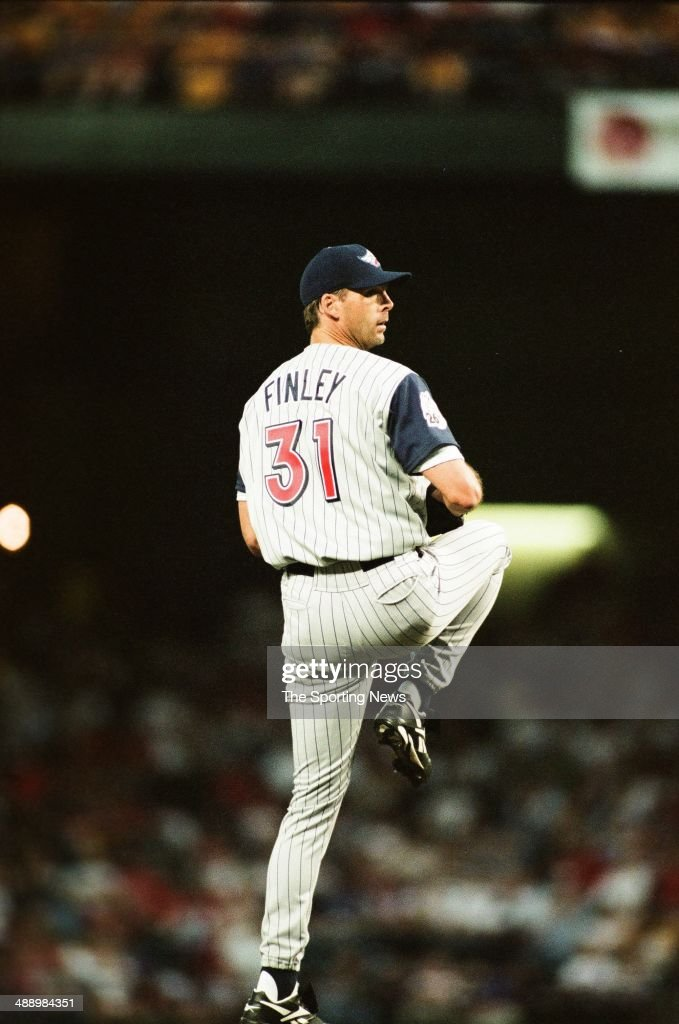 <a gi-track='captionPersonalityLinkClicked' href=/galleries/search?phrase=Chuck+Finley&family=editorial&specificpeople=242777 ng-click='$event.stopPropagation()'>Chuck Finley</a> of the Los Angeles Angels of Anaheim pitches against the Texas Rangers at Rangers Ballpark in Arlington on April 9, 1999 in Arlington, Texas. The Angels defeated the Rangers 8-4.
