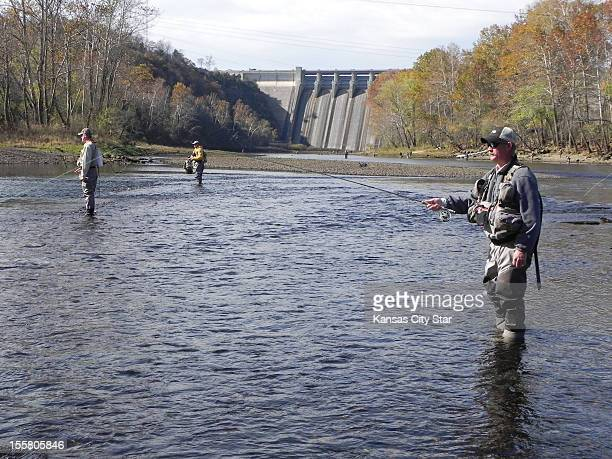 Chuck Gries joins the crowd fishing the shallow water below Table Rock Dam in the Trophy Area at Lake Taneycomo Using scud and sculpin flies he...