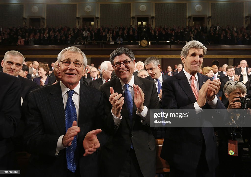 Chuck Hagel, U.S. secretary of defense, left, Jacob 'Jack' Lew, U.S. Treasury secretary, center, and John Kerry, U.S. secretary of state, applaud following U.S. President Barack Obama's State of the Union address to a joint session of Congress at the Capitol in Washington, D.C., U.S., on Tuesday, Jan. 28, 2014. Obama offered modest steps to chip away at the country's economic and social challenges in a State of the Union address that reflects the limits of his power to sway Congress. Photographer: Larry Downing/Pool via Bloomberg