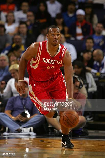 Chuck Hayes of the Houston Rockets dribbles the ball during their game against the Golden State Warriors at Oracle Arena on October 28 2009 in...